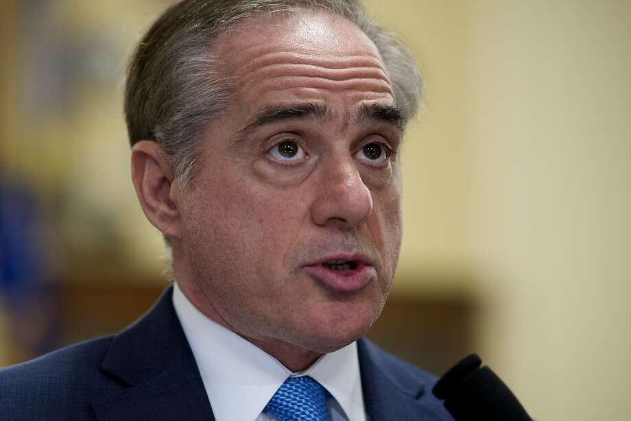 FILE - In this March 7, 2017, file photo, Secretary of Veterans Affairs David Shulkin, addresses a House Veterans' Affairs Committee's hearing on Captiol Hill in Washington. The Department of Veterans Affairs is telling skeptical lawmakers it has already fixed problems with its suicide hotline that were highlighted in an internal watchdog's report released just two weeks ago. (AP Photo/Cliff Owen, File) Photo: Cliff Owen, Associated Press