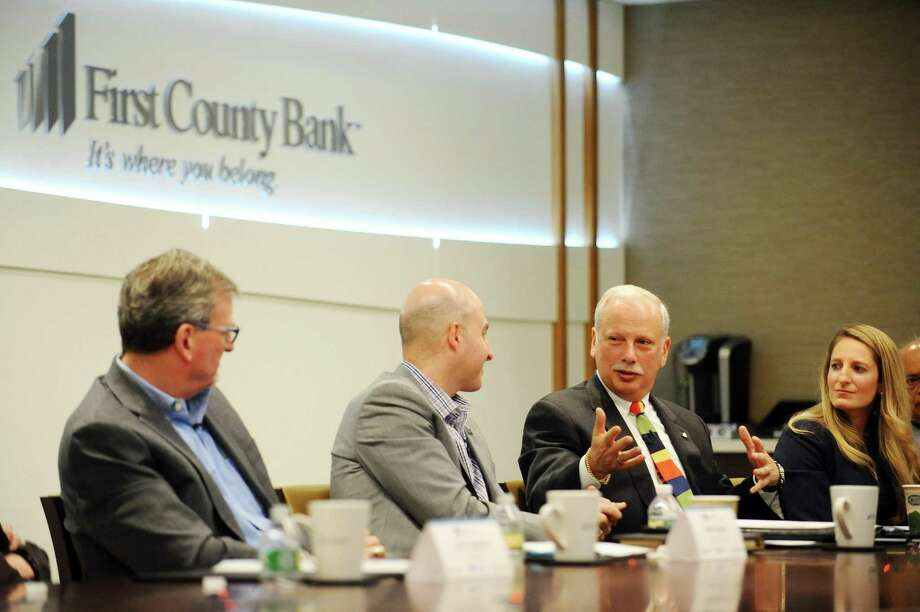 Chairman and CEO of First County Bank Rey Giallongo, second from right, talks during a roundtable discussion about philanthropic strategies at First County Bank's headquarters in Stamford on Tuesday. Photo: Michael Cummo / Hearst Connecticut Media / Stamford Advocate