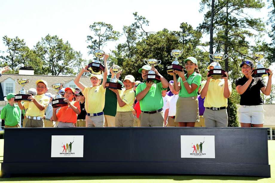AUGUSTA, GA - APRIL 02:  (L-R) Carter Gaede, Maye Huang, Liam Hartling, Lucy Yuan, Zachary Colon, Alexa Pano, Mason Quagliata and Savannah Grewal pose with trophies for their overall wins during the Drive, Chip and Putt Championship at Augusta National Golf Club on April 2, 2017 in Augusta, Georgia.  (Photo by Harry How/Getty Images) Photo: Harry How, Staff / 2017 Getty Images