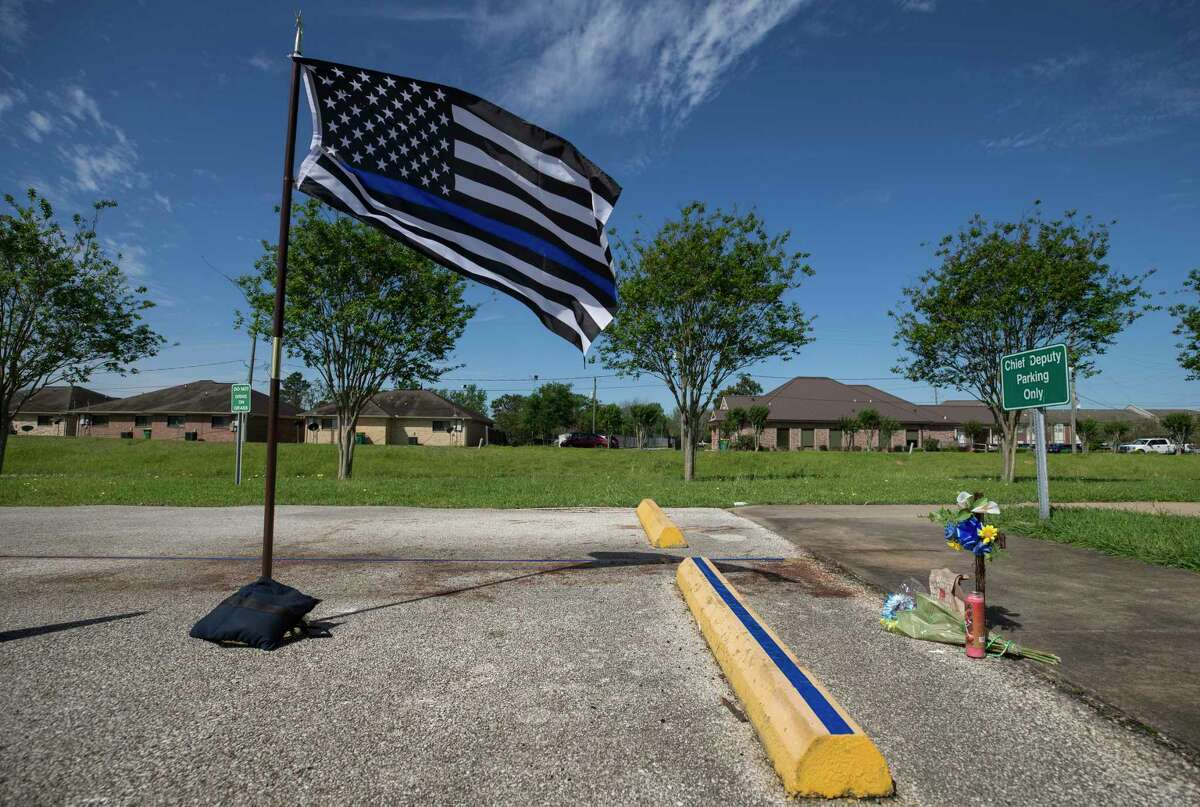 A memorial for Harris County Precinct 3 Assistant Chief Deputy Clinton Greenwood was set at his parking spot outside the Baytown Courthouse Tuesday, April 4, 2017, in Baytown, Texas. Greenwood was fatally shot at that parking spot as he arrived to work Monday morning.