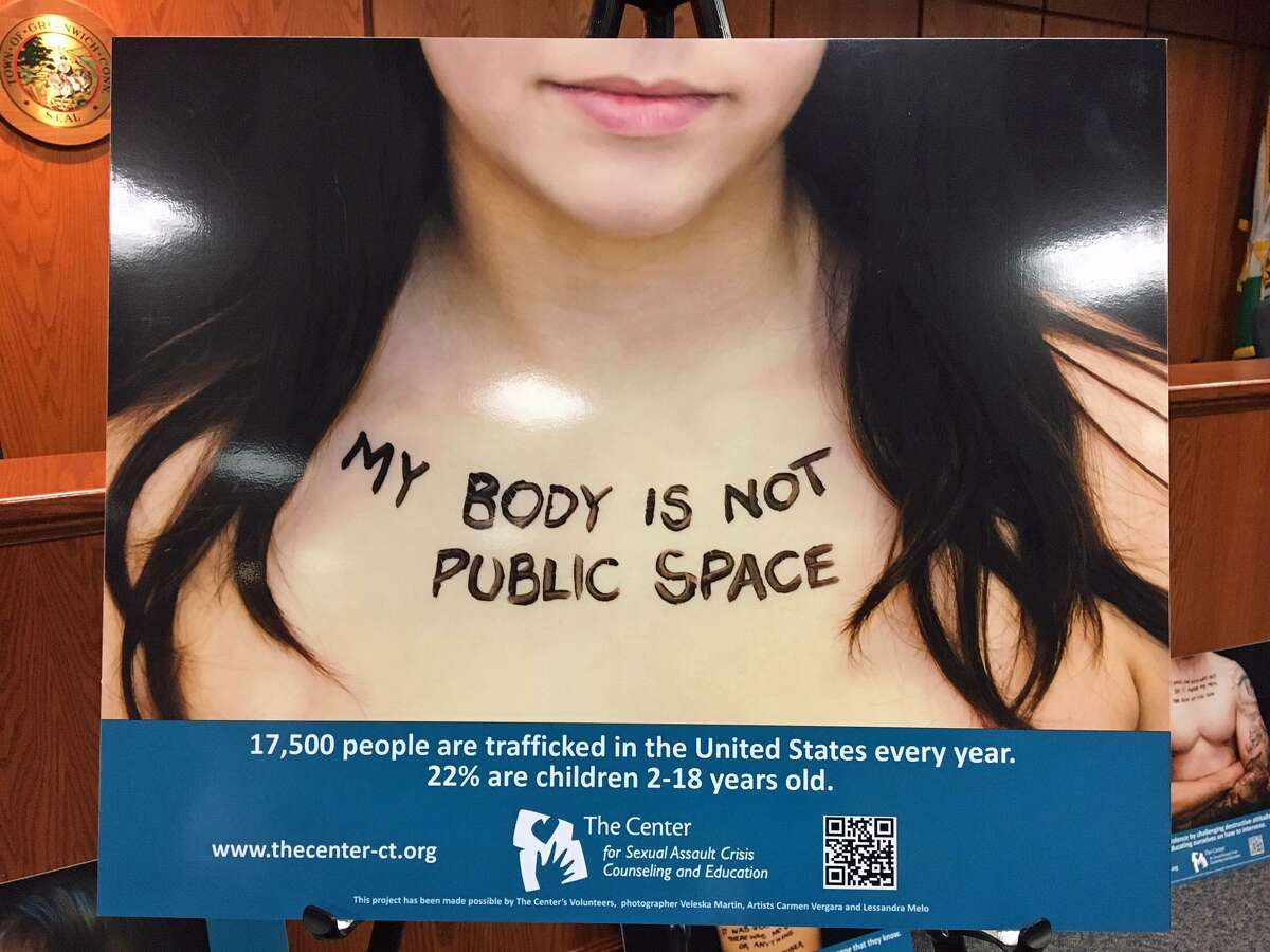 """In order to raise awareness for the issue of sexual assault, the Center for Sexual Assault Crisis Counseling and Education will display photographs with messages about sexual assault in the Greenwich Town Hall from April 1 to April 15. The series """"Reveal to Heal,"""" by photographer Veleska Martin of Norwalk, features modestly undressed models with statements painted on their bodies."""