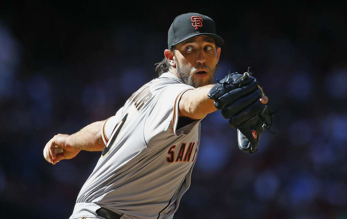 San Francisco Giants' Madison Bumgarner throws a pitch against the Arizona Diamondbacks during the sixth inning of an Opening Day baseball game Sunday, April 2, 2017, in Phoenix. (AP Photo/Ross D. Franklin)