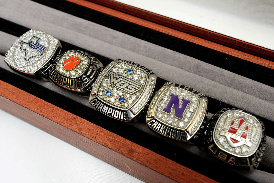 Rings from left: West Orange-Stark's 2015 football state championship, West Brook's 2011 weightlifting national championship, West Orange-Stark's 2011 track state championship, Newton's 2013 track state championship and Memorial's 2015 track state runner-up at Balfour. Photo taken Wednesday 3/22/17 Ryan Pelham/The Enterprise Photo: Ryan Pelham, Ryan Pelham/The Enterprise / ©2017 The Beaumont Enterprise/Ryan Pelham