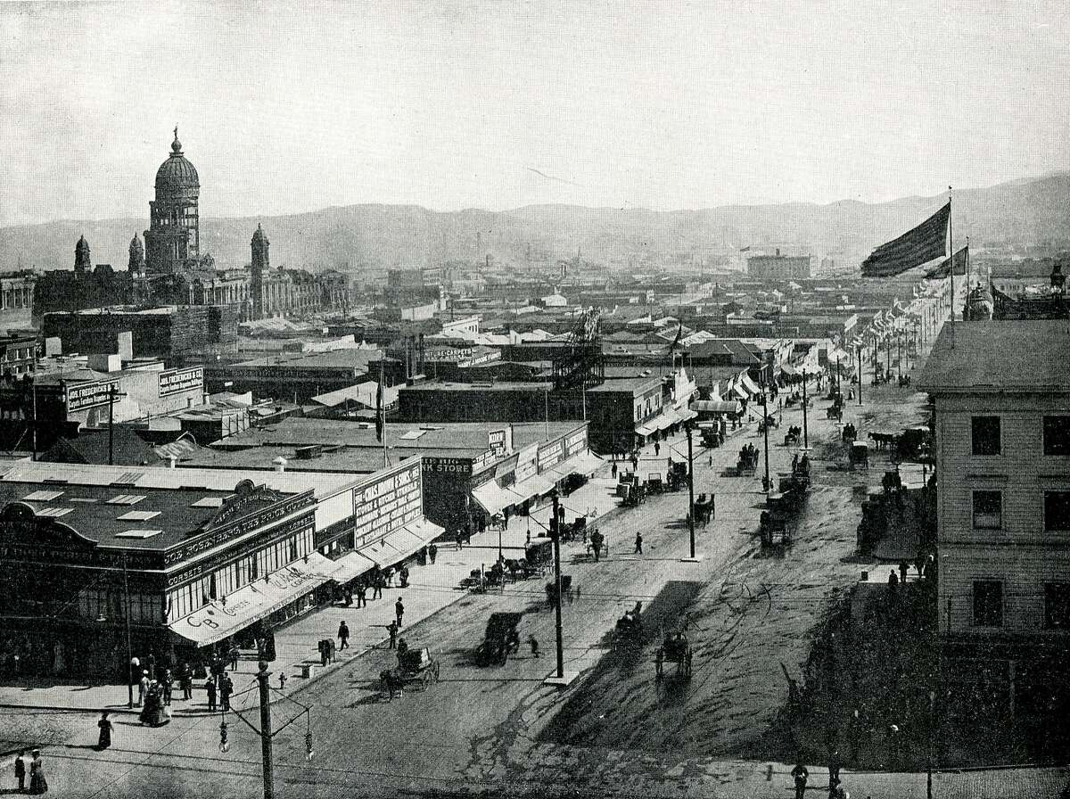 Temporary stores erected along Van Ness Avenue immediately after the great fire. Ruins of City Hall on the left.