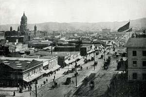 "Temporary stores erected along Van Ness Avenue immediately after the great fire. Ruins of City Hall on the left. ""The New San Francisco - Two Years After the Great Fire"""