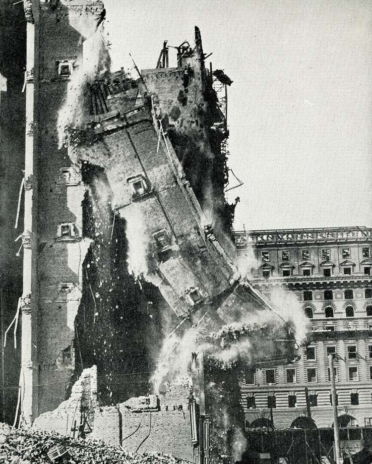 "Razing the walls of the old Palace Hotel, one of the most  spectacular photographs taken during the rebuilding of San Francisco. These walls were pulled down with wire cables operated by donkey engine. ""The New San Francisco - Two Years After the Great Fire"" Photo: From The Collection Of Bob Bragman"