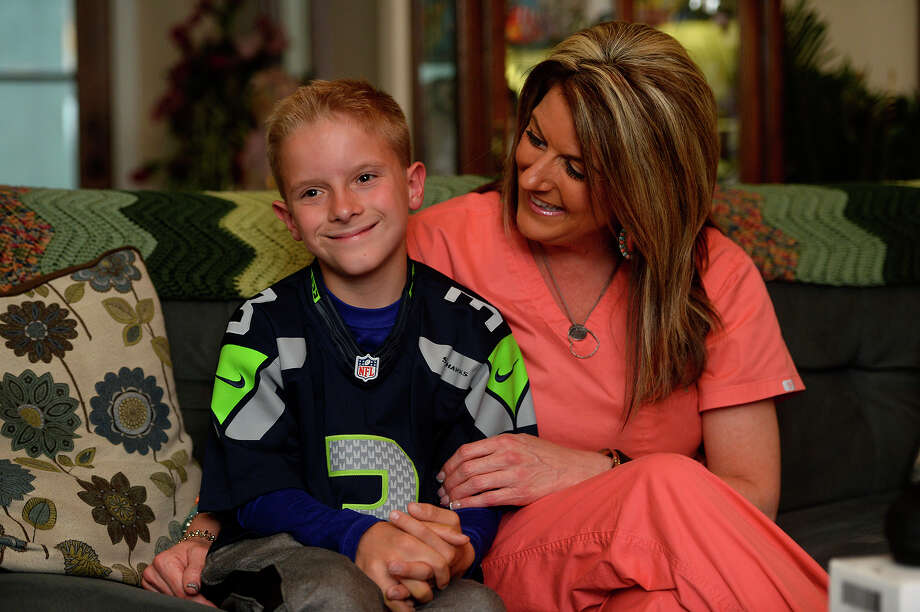 Karsten Scarborough sits with his mother, Tiffany, during an interview on Wednesday. Ivory Gilcher, a teacher at his school, recently raised money to buy him a pair of Enchroma glasses to correct his color blindness.  Photo taken Wednesday 3/29/17 Ryan Pelham/The Enterprise Photo: Ryan Pelham, Ryan Pelham/The Enterprise / ©2017 The Beaumont Enterprise/Ryan Pelham