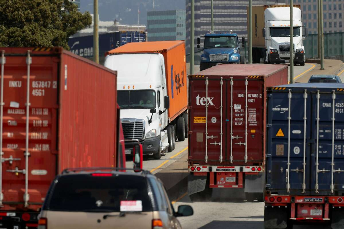 Semi-trailer trucks entering and leaving the Port of Oakland, Ca. on Tues. April 4, 2017.