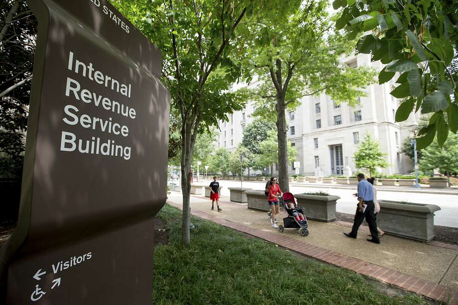 In this photo taken Aug. 19, 2015, the Internal Revenue Service Building in Washington. The IRS says it is once again using private debt collectors to go after tax delinquents. The resumption of the program comes amid a wave of telephone scams in which fake IRS agents try to con innocent taxpayers out of their money. (AP Photo/Andrew Harnik) Photo: Andrew Harnik, Associated Press