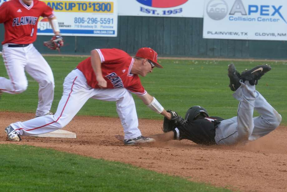 Plainview second baseman Treyton Peterson stretches to tag out a Dumas runner attempting to steal a base during a District 3-5A baseball game last week. The Bulldogs defeated Dumas Monday 16-5 for their fifth win in six district outings. Photo: Skip Leon/Plainview Herald