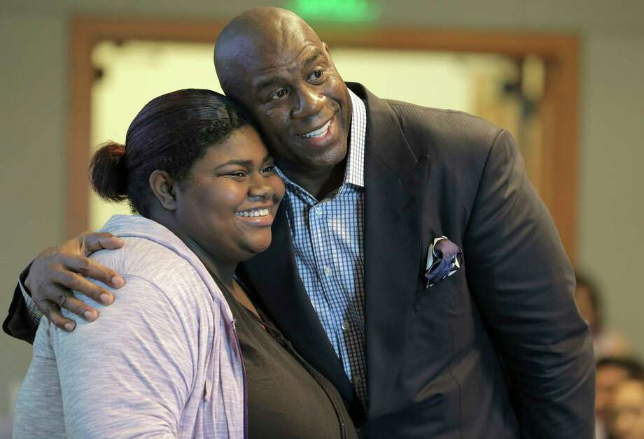 Magic Johnson has his picture taken Tuesday with a high school student during a Houston Money Week event. Photo: Elizabeth Conley, Staff / © 2017 Houston Chronicle