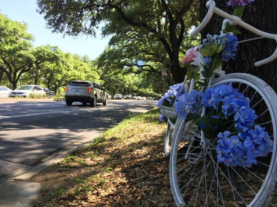 A ghost bike has been placed on Main Street to honor Marjorie Corcoran, a Rice professor who was struck and killed by a Metro train while riding her bicycle to campus. Photo: Jay Dryden