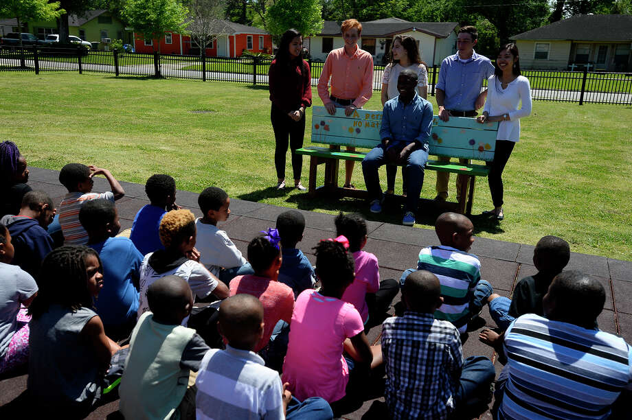 West Brook High School students from Youth Leadership Southeast Texas talk to first graders about the buddy bench they made for the playground at Jones-Clark Elementary School on Tuesday. The bench will give students a place to sit and find new friends when they don't have anyone to play with. Photo taken Tuesday 4/4/17 Ryan Pelham/The Enterprise Photo: Ryan Pelham / ©2017 The Beaumont Enterprise/Ryan Pelham