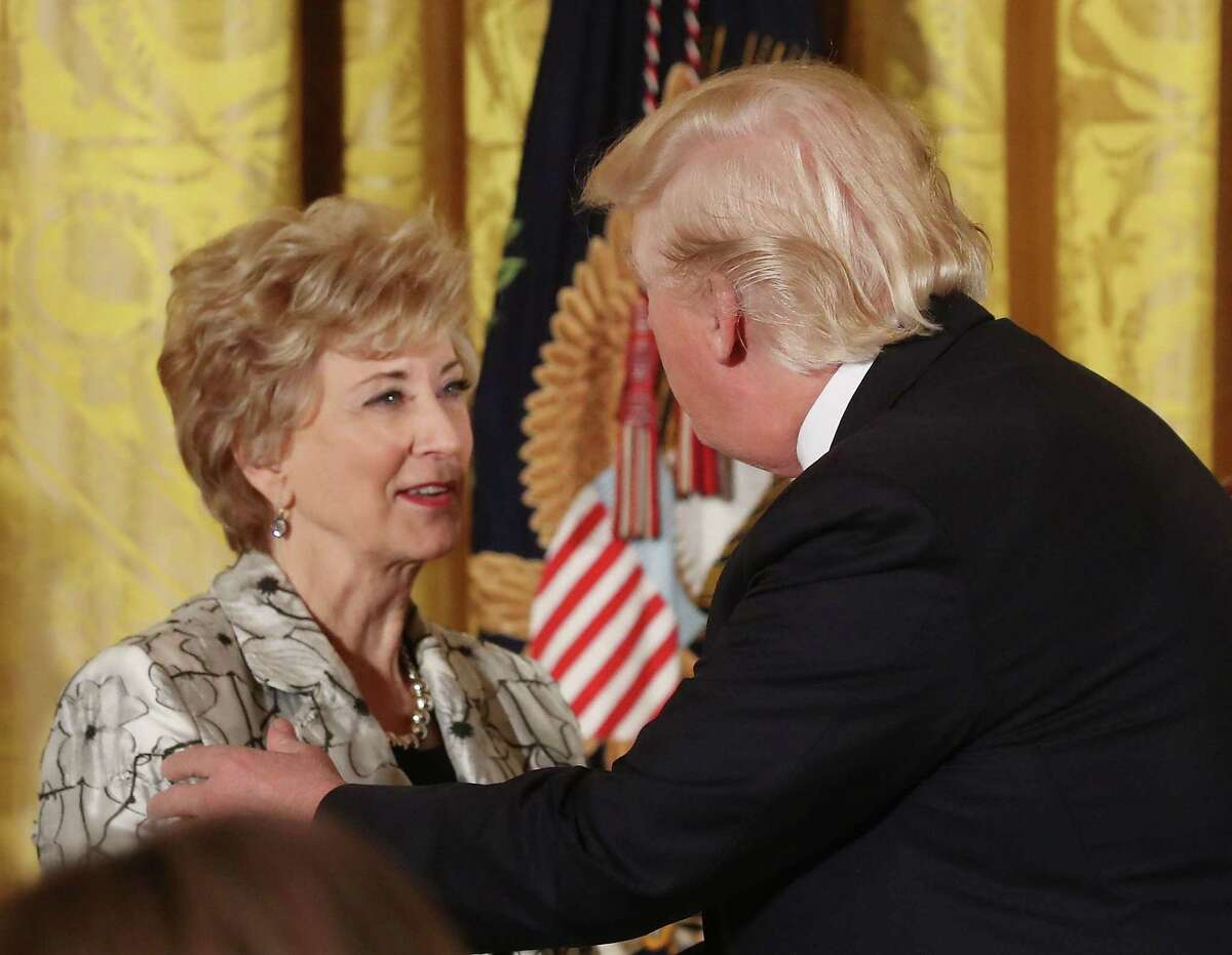 U.S. President Donald Trump greets Small Business Administration head Linda McMahon during an event celebrating Women's History Month, in the East Room at the White House March 29, 2017 in Washington, DC.
