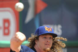 RockHounds' Grant Holmes warms up during media day April 4, 2017, at Security Bank Ballpark.  James Durbin/Reporter-Telegram