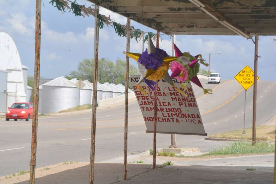 Winds gusting to 40 mph Tuesday had a hanging sign and piñatas on the porch outside El Mercadito Rodriguez, 608 E. Fifth, dancing in the strong breeze. A light shower moved through about 3:30 p.m. Tuesday, resulted in 0.02 inch of rainfall.