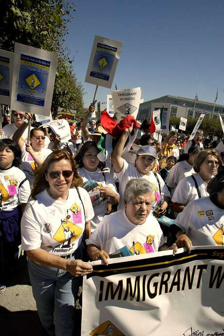 The Immigrant Workers Freedom Ride marched from Yerba Buena to the Civic Center on Sept. 20, 2003 in San Francisco. Photo: LIZ HAFALIA, SFC