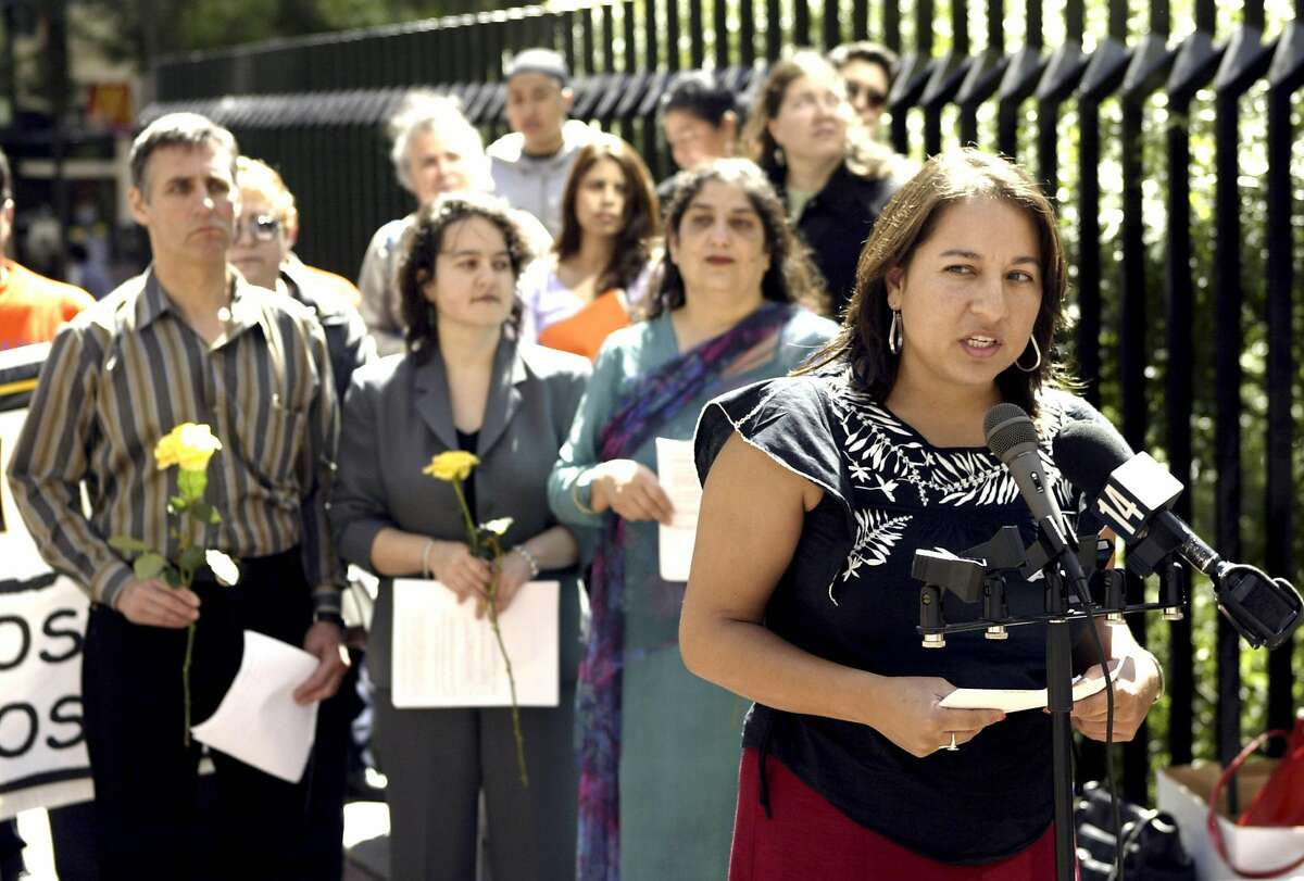 Martha Benitez, coordinator of the Northern California Immigrant Workers Freedom Rides Coalition, holds a press conference in front of Sen. Dianne Feinstein's San Francisco office in May 2004 to call attention to comprehensive immigration reform legislation.