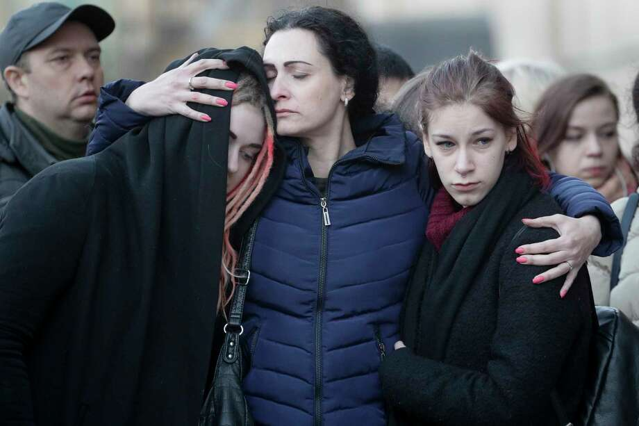 People react at a symbolic memorial at Technologicheskiy Institute subway station in St. Petersburg, Russia, Tuesday, April 4, 2017. A bomb blast tore through a subway train deep under Russia's second-largest city St. Petersburg Monday, killing several people and wounding many more in a chaotic scene that left victims sprawled on a smoky platform. (AP Photo/Dmitri Lovetsky) Photo: Dmitri Lovetsky, STF / Copyright 2017 The Associated Press. All rights reserved.