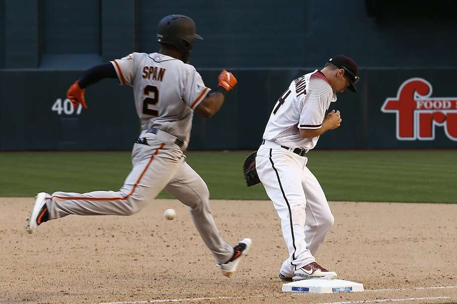 San Francisco Giants' Denard Span (2) stretches out to first base for a single as Arizona Diamondbacks' Paul Goldschmidt, right, misses the ball during the ninth inning of an Opening Day baseball game Sunday, April 2, 2017, in Phoenix.  Photo: Ross D. Franklin, Associated Press