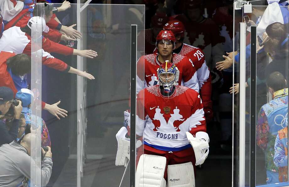 """FILE - In this Feb. 15, 2014, file photo, Russia goaltender Semyon Varlamov, front, and Russia forward Alexander Ovechkin, second,  lead the Russian team onto the ice for warmups before playing the USA in a men's ice hockey game at the 2014 Winter Olympics,  in Sochi, Russia.  Ovechkin and other players are raising doubts about the finality of the NHL announcement that it won't participate in the 2018 Olympics. The Washington Capitals superstar reiterated his intention to represent Russia next year in South Korea, calling the league's decision not to go a """"bluff.""""(AP Photo/Petr David Josek, File) Photo: Petr David Josek, Associated Press"""