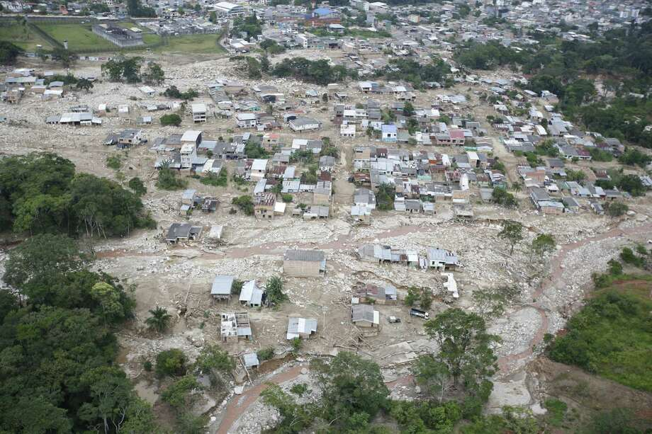 Destroyed homes are seen from the air in Mocoa, Colombia, on Tuesday. Authorities said at least 273 people were killed when rivers overflowed. Photo: Fernando Vergara, STF / Copyright 2017 The Associated Press. All rights reserved.