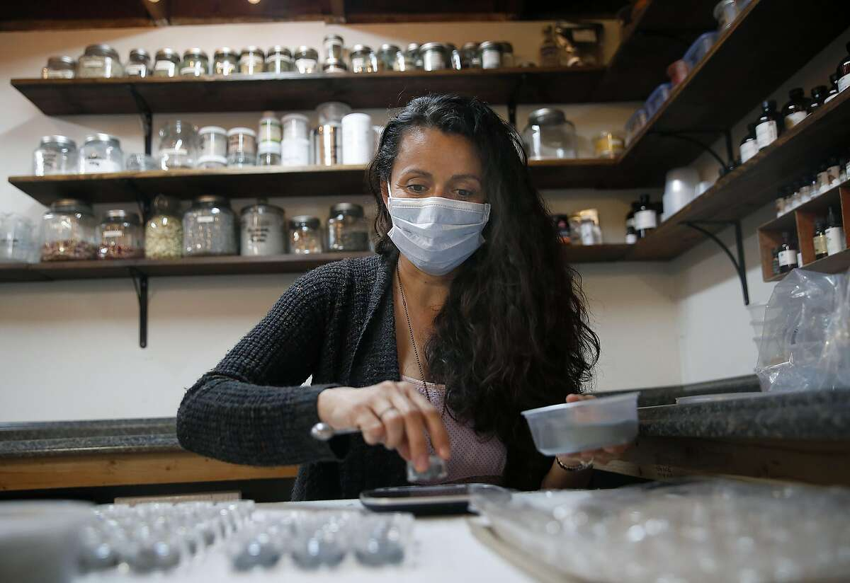 Michelle Adams, an Etsy seller who makes all-natural beauty and bath products called Cosmic, working with eye shadows in her home studio on Monday, April 3, 2017, in Turlock, Calif.
