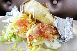 Taco Taco Cafe: In its 20 years at Hildebrand and McCullough, Taco Taco's been celebrated by TV tastemakers Guy Fieri, Rachael Ray and Alton Brown for its oversize tacos and larger-than-life owner Helen Velesiotis. You'll celebrate it for a puffy taco with a half-crisp masa shell as tawny, smooth and strong as parchment. 145 E. Hildebrand Ave., 210-822-9533, tacotacosa.com