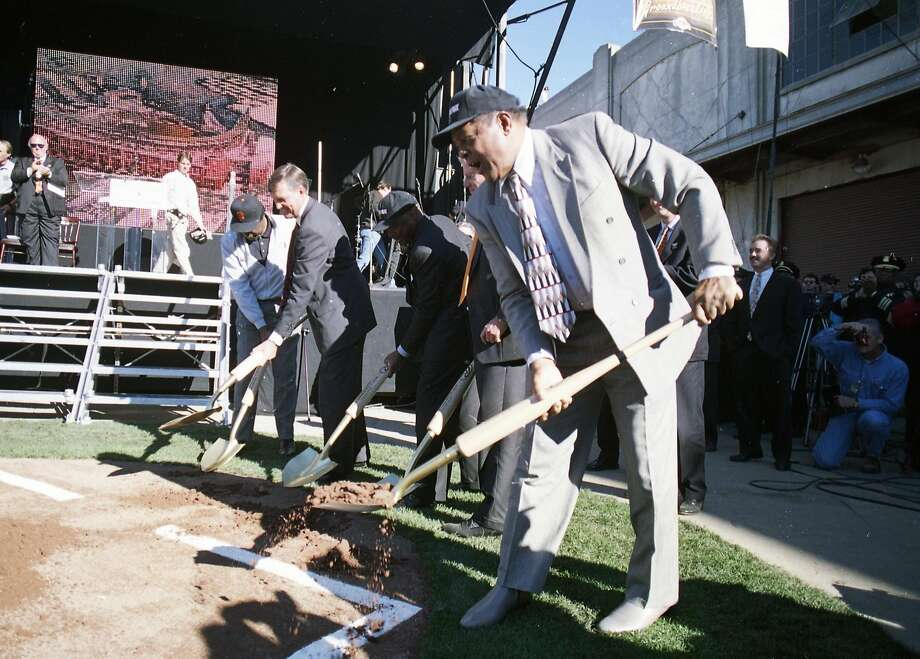 Groundbreaking at Pac Bell Park, the new Giants ballpark in China Basin. Willie Mays and other dignitaries scoop dirt onto a ceremonial home plate on Dec. 11, 1997. Photo: Brant Ward, The Chronicle