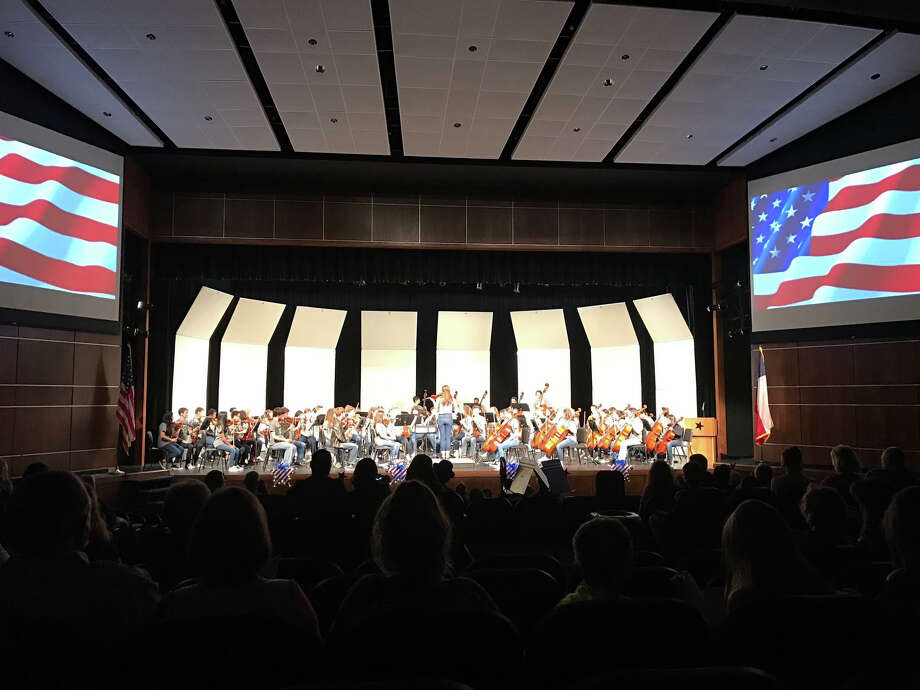 The Kingwood Park High School Orchestra performs an America-themed concert as their second annual Kingwood Park Orchestra Benefit Concert, to benefit the Wounded Warrior Project, at the high school's Performing Arts Center Thursday, March 30. Photo: Courtesy Of Kingwood Park High School Orchestra