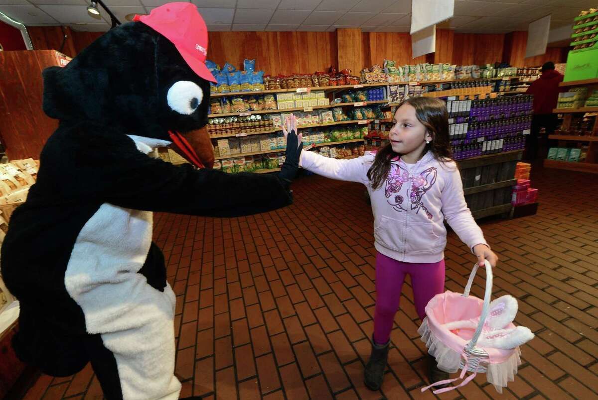 Angela Mantos, 7 of Norwalk, is greeted by a costumed character during Stew Leonard?'s Easter Egg Hunt Eggs-Travaganza Tuesday, April 4, 2017, at their store in Norwalk, Conn. Children age 9 and under were be given a map of Stew Leonard?'s and a bag to collect eggs from costumed characters throughout the store, including Wow the Cow, Cynthia Chick, and Daphne Duck among others. Each egg contained prizes ranging from candy and board games to toys and gift cards including the Egg Hunt?'s top prize of $250 gift card to Toys R Us!
