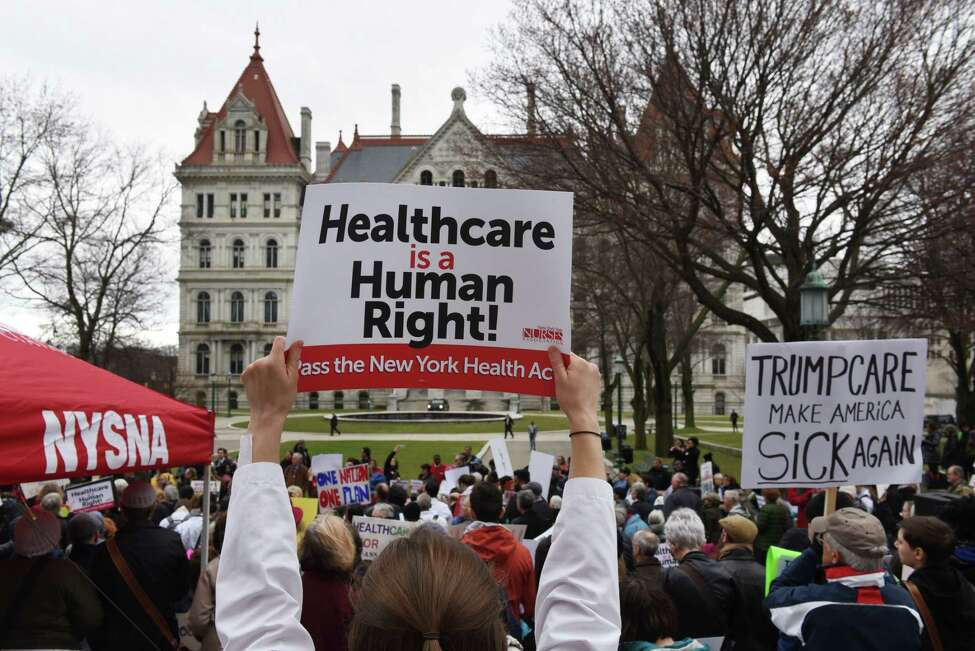 Healthcare advocates, including patients, nurses, doctors, and business owners, rally at West Capitol Park to push for passage of the New York Health Act on Tuesday, April 4, 2017, in Albany, N.Y. The Act calls for a comprehensive system of access to health insurance for New York state residents. (Will Waldron/Times Union)