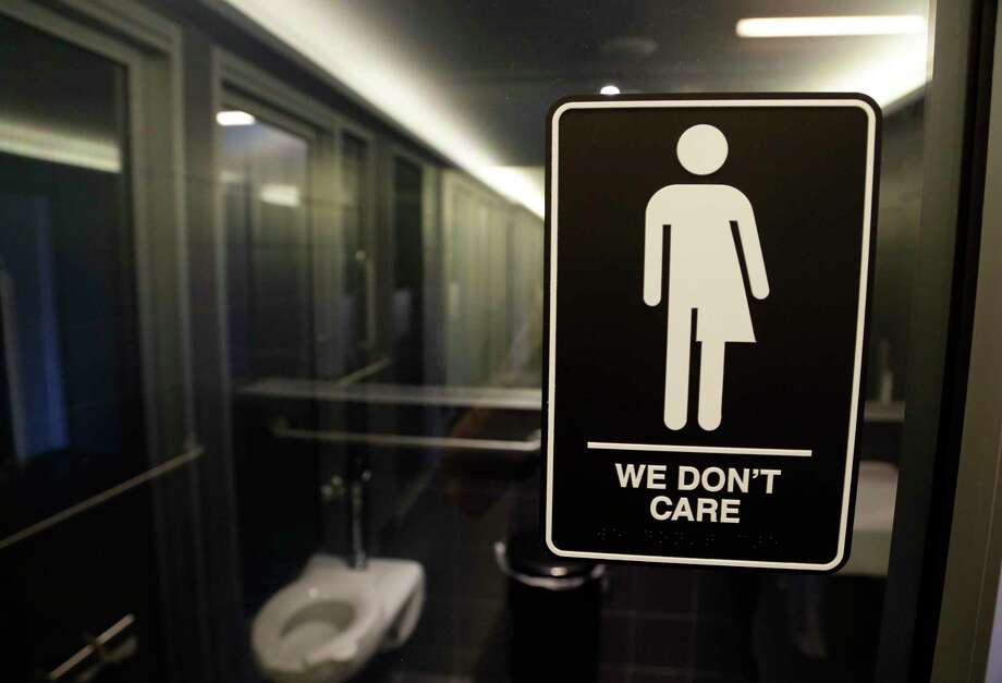 FILE - This Thursday, May 12, 2016, file photo, shows a sign outside a restroom at 21c Museum Hotel in Durham, N.C. The North Carolina state Legislature last week repealed a law preventing t ransgender people from using public restrooms and locker rooms that didn't match the gender on their birth certificate. (AP Photo/Gerry Broome, File) Photo: Gerry Broome, STF / Copyright 2017 The Associated Press. All rights reserved.