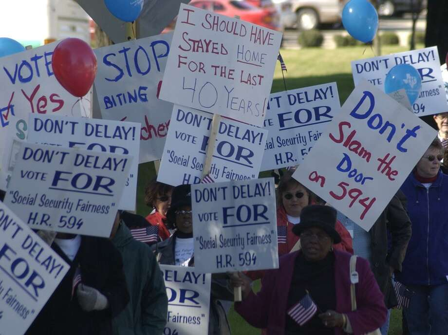 Back in 2003, the Texas Federation of Teachers held a protest rally in front of the Stafford office of Rep. Tom DeLay. Their woes continue in 2017, where a special session of the state Legislature is considering bills to help teacher retirees. Photo: Steve Ueckert /Houston Chronicle / Houston Chronicle