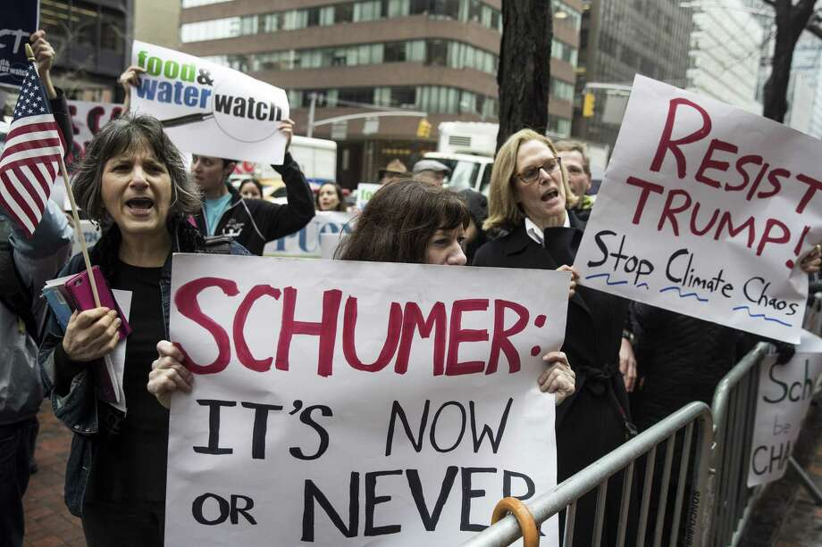 NEW YORK, NY - APRIL 4: Activists rally in support of the Environmental Protection Agency (EPA) outside of Senate Minority Leader Chuck Schumer's (D-NY) Midtown Manhattan office, April 4, 2017 in New York City. President Donald Trump's proposed budget plans would cut funding to the Environmental Protection Agency (EPA) by 31 percent. (Drew Angerer/Getty Images) ORG XMIT: 700030131 Photo: Drew Angerer / 2017 Getty Images
