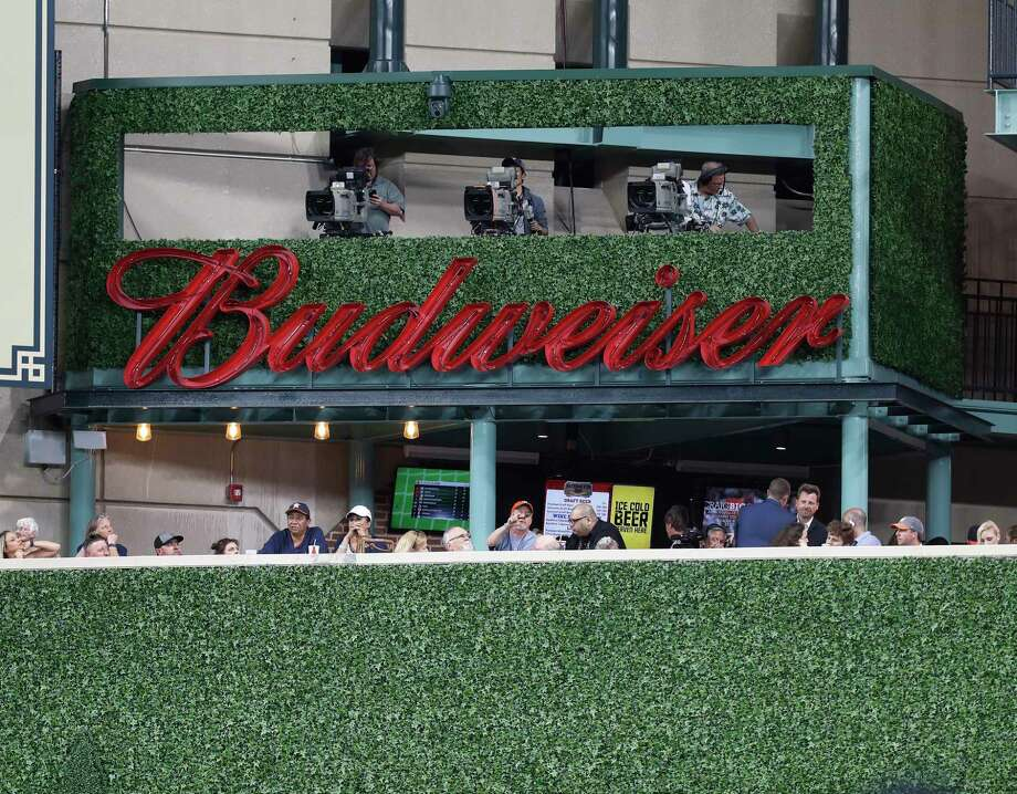 The new center field camera platform at Minute Maid Park in Houston is called the Budweiser Batter's Eye patio. It's shown here during the Astros' game against the Seattle Mariners, April 4, 2017. Budweiser, owned by Anheuser-Busch InBev, asked Houston artist Eddie Martinez to design an Astros-themed beer can, which is available for purchase in Houston stores, April 2017.Keep clicking to see a game-by-game record of the Astreos' 2017 season: Photo: Karen Warren, Houston Chronicle / 2017 Houston Chronicle