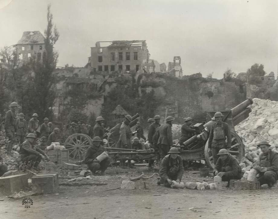 """Original caption: """"1st U.S. official photograph of the American advance. An American Battery of 155 m.m. Howitzers firing from the ruins of the captured town of Varennes (France) at the retreating German columns."""" Photo: Courtesy U.S. Army Heritage And Education Center"""