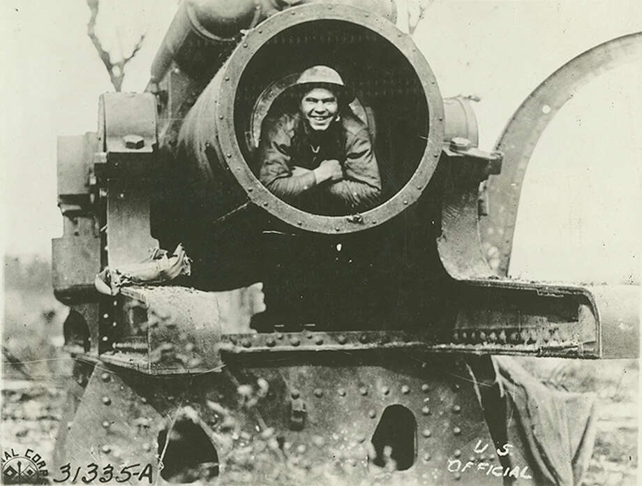 """Original caption: """"Member of the 132nd Reg. Inf.,(formerly 2nd and 7th Reg. Inf., Illinois Nat'l Guards), in the muzzle of the big 38-cm. gun left behind by the Germans. 33rd Division. Dannevoux, Meuse, France, Oct. 18th, 1918."""" Photo: Courtesy U.S. Army Heritage And Education Center"""