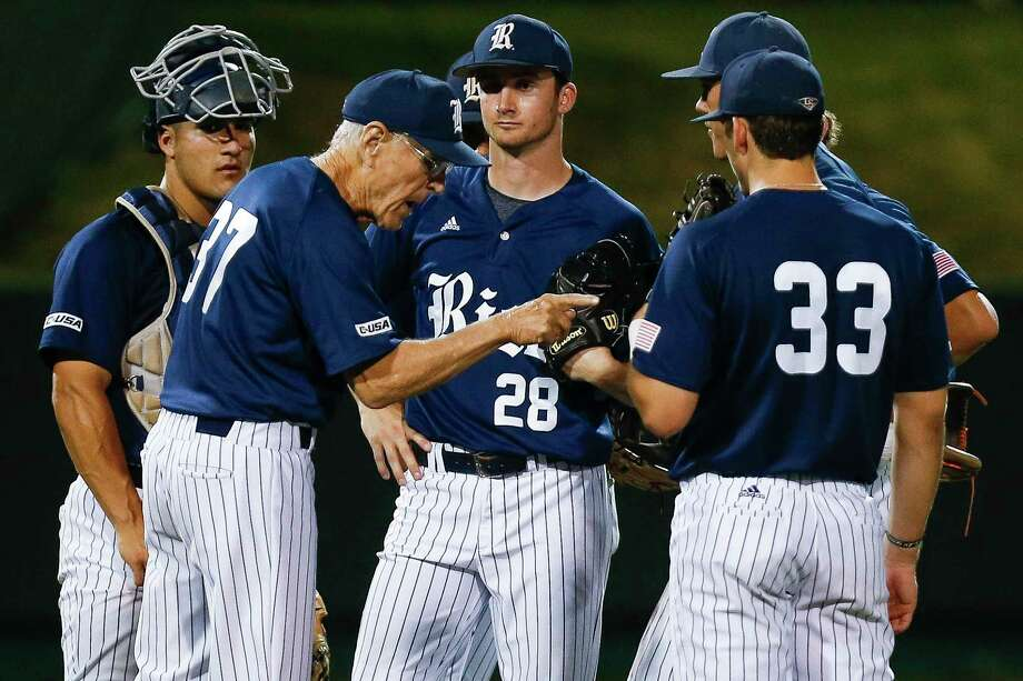 Rice head coach Wayne Graham talks to his players before taking Rice pitcher Kendal Jefferies (28) out after five no hit innings as Houston takes on Rice at Schroeder Park Tuesday, April 4, 2017 in Houston. Photo: Michael Ciaglo, Houston Chronicle / Michael Ciaglo