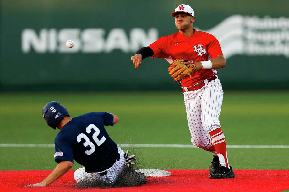 Houston infielder Jake Scheiner (2) gets Rice outfielder Brad Gneiting (32) out at second but fails to turn a double play as Houston takes on Rice at Schroeder Park Tuesday, April 4, 2017 in Houston. Photo: Michael Ciaglo, Houston Chronicle / Michael Ciaglo