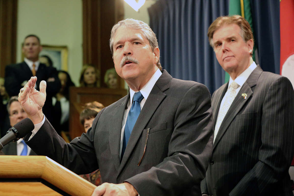 Sen. Larry Taylor announces plans from the Senate Committee on Education during a press conference with Lt. Governor Dan Patrick on March 3, 2015. Taylor and Patrick want to create a so-called school voucher program allowing students to attend private schools using public school funds, although the House refuses to go along with their plan.