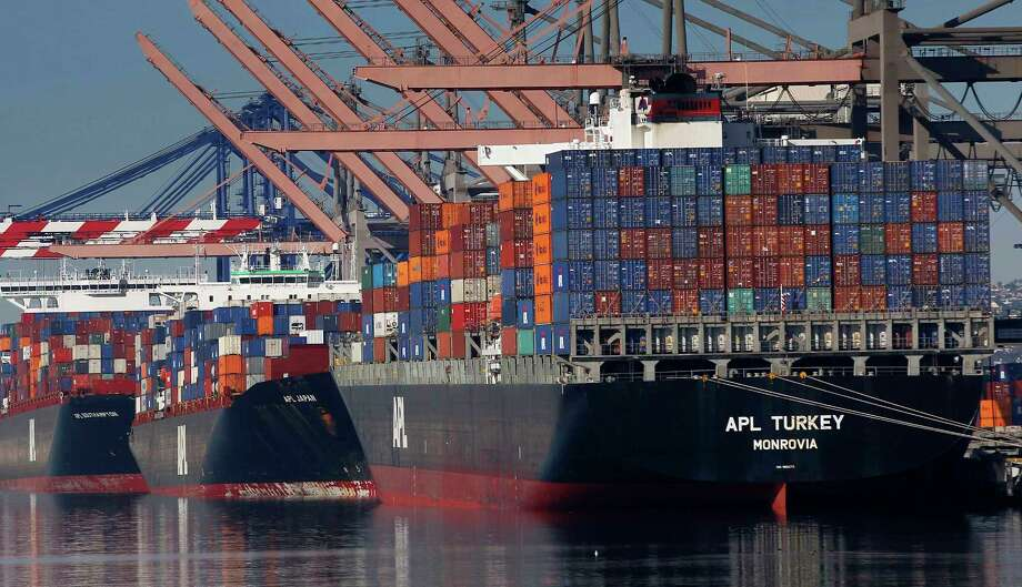 Container ships wait to be unloaded at the Port of Los Angeles.  The U.S. trade deficit plunged in February as imports from China declined.  Photo: Nick Ut, STF / Copyright 2017 The Associated Press. All rights reserved.