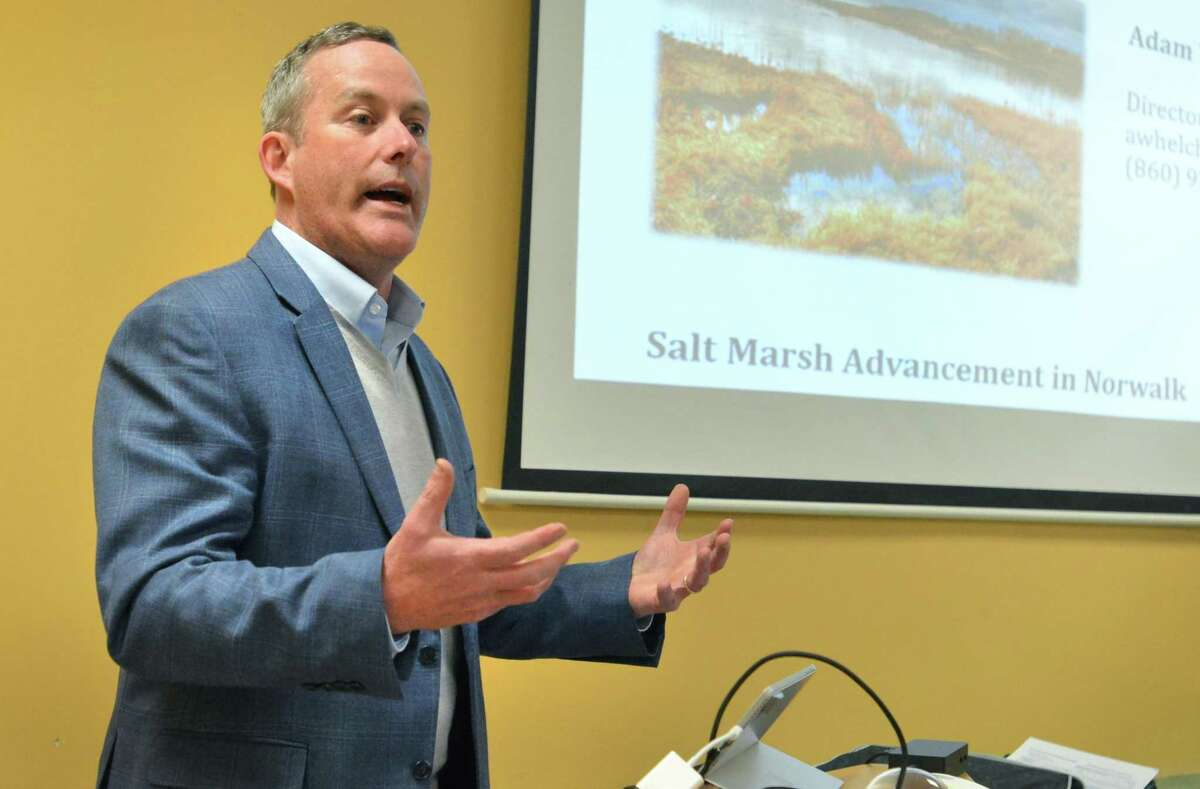 Adam Whelchel PhD, director of Science at The Nature Conservancy of Connecticut, talks about rising sea levels and conservation at The Norwalk Land Trust Annual Meeting at the Rowayton Community Center on Tuesday .