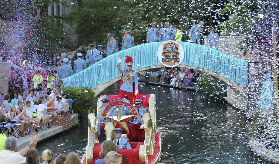 """King Antonio XCII De Miller enters the Arneson River Theatre during the 2014 Texas Cavaliers River Parade """"River Wild"""" April 21, 2014. Photo: Express-News File Photo / © 2014 San Antonio Express-News"""