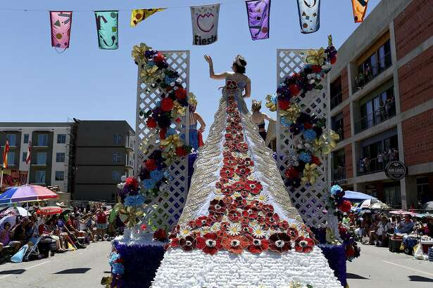 Sophie Hilliard Larkin, the Duchess of Bountiful Harvests, waves to the crowd during the Battle of Flowers Parade on April 22, 2016.