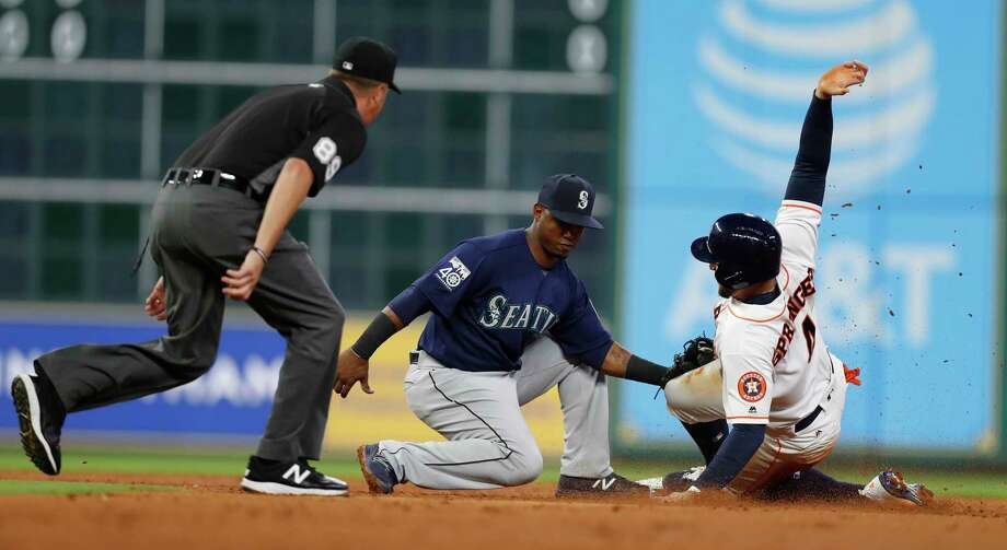 Houston Astros George Springer (4) is caught stealing second base by Seattle Mariners shortstop Jean Segura (2) during the third inning of an MLB baseball game at Minute Maid Park, Tuesday, April 4, 2017, in Houston.   ( Karen Warren / Houston Chronicle ) Photo: Karen Warren, Staff Photographer / 2017 Houston Chronicle