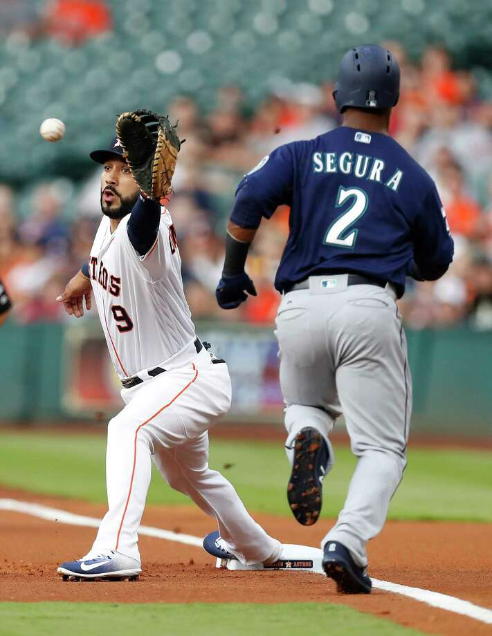 Seattle Mariners shortstop Jean Segura (2) grounds out at first base to  Houston Astros Marwin Gonzalez (9) during the first inning of an MLB baseball game at Minute Maid Park, Tuesday, April 4, 2017, in Houston.   ( Karen Warren / Houston Chronicle ) Photo: Karen Warren, Staff Photographer / 2017 Houston Chronicle