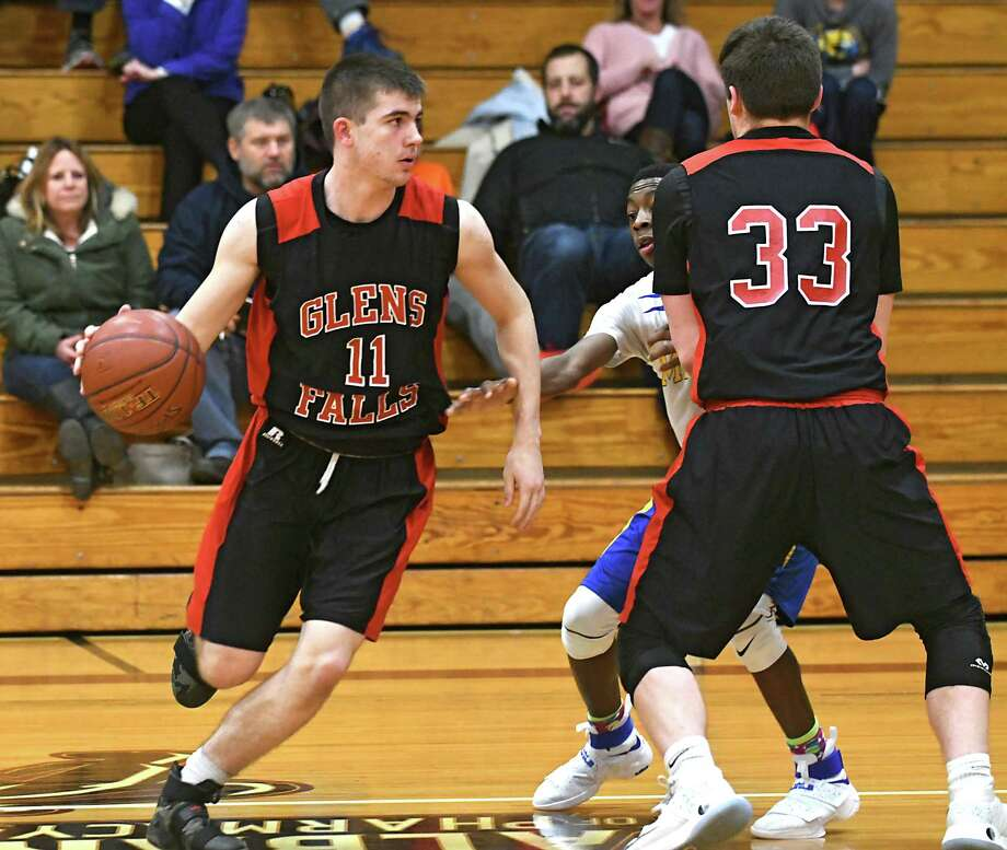 Glens Falls' Joseph Girard, left, uses a pick by teammate Conor Schliff during a basketball game against Bishop Maginn at Albany College of Pharmacy on Monday, Dec. 19, 2016 in Albany, N.Y. (Lori Van Buren / Times Union) Photo: Lori Van Buren / 20039182A