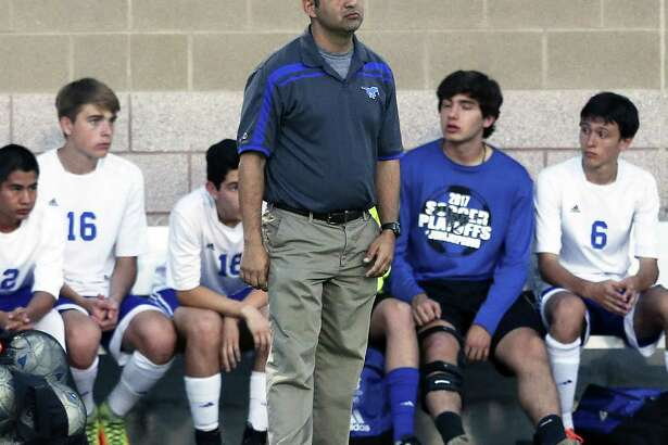 Jay coach David Johnson watche sfrom the sideline as Jay plays Clark in Class 6A third-round boys soccer playoffs at Farris Stadium on April 4, 2017.