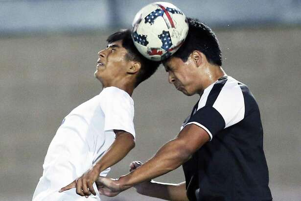 Jay's Israel Hernandez (left) and Clark's Alec Asencio contend for control of the ball in a Class 6A third-round boys soccer playoff match at Farris Stadium on April 4, 2017.
